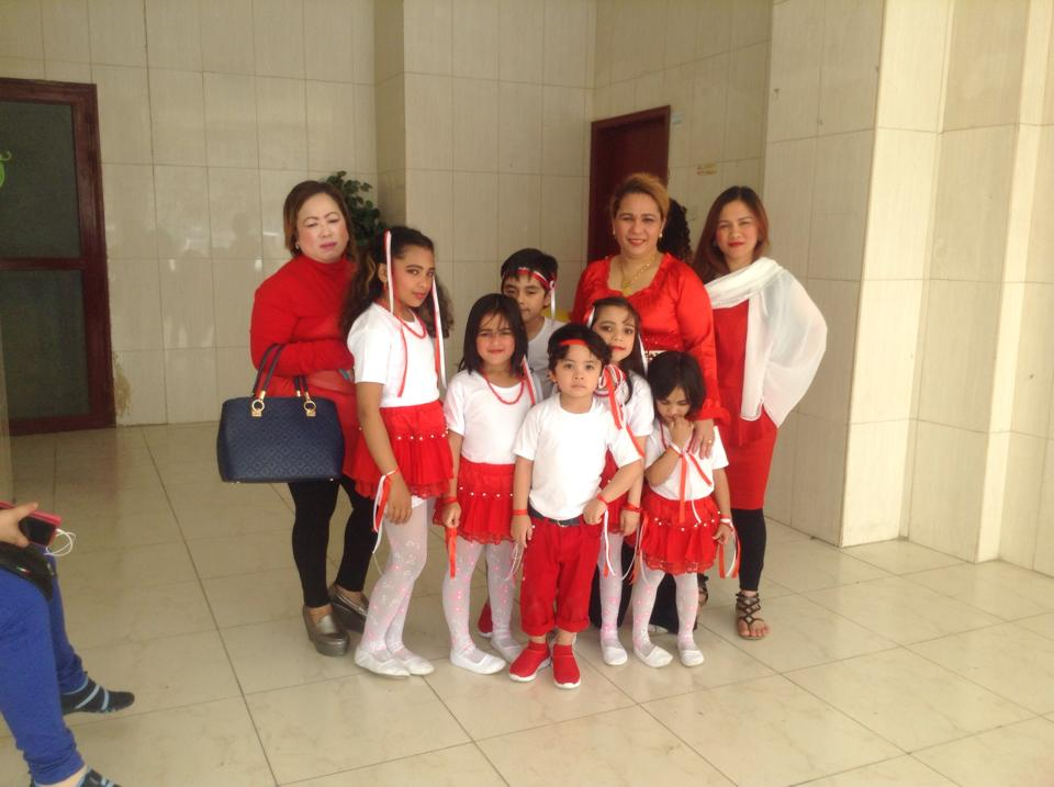 With IWOK family and their children before a performance for charity.