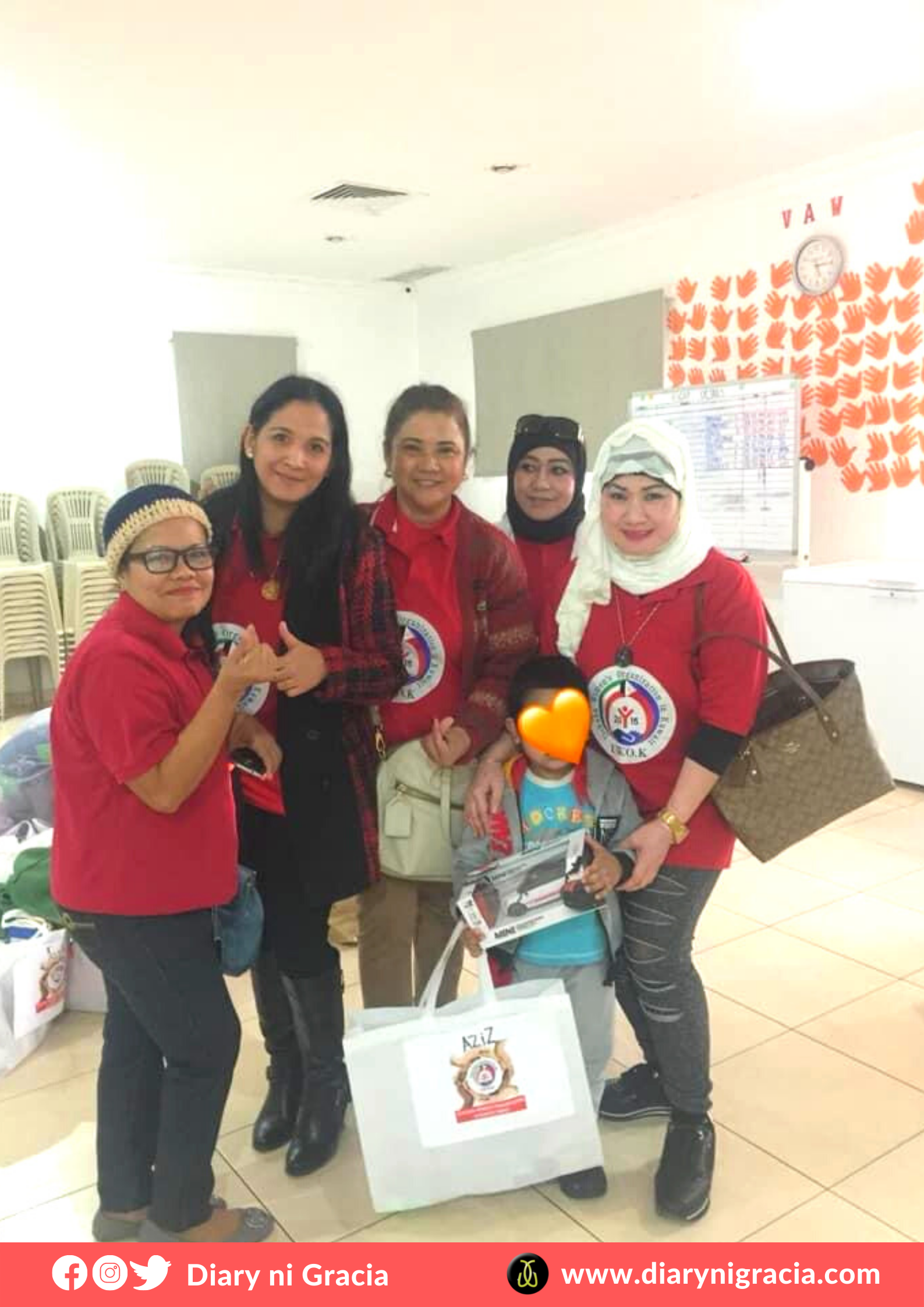 Aziz with IWOK Team, receiving the gift