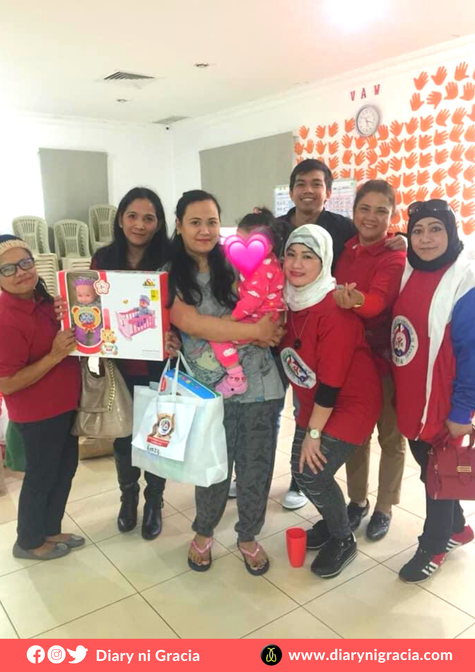 Kenzy with the IWOK team, receiving the gift